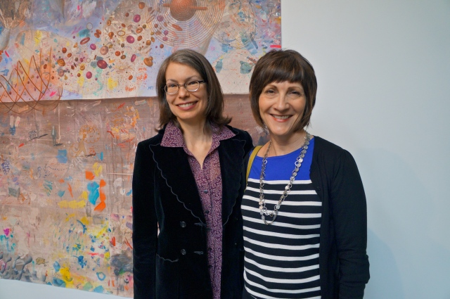 Artist and writer Julia Stoops visits with Jackie Shannon Hollis, another writer, at the opening of her art exhibit at PCC-Sylvania last month.