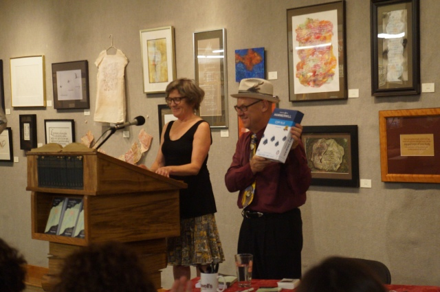 Joanna Rose presents her co-teacher Stevan Allred with blank paper.