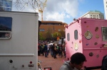 A view past the Voodoo Donuts' iconic pink truck.