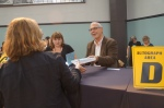 My author Dan Berne signs copies of his debut novel, THE GODS OF SECOND CHANCES, after speaking to a luncheon crowd.