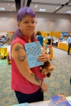 Bookseller Darilee Bedner of Third Street Books in Marysville, Washington, shows how Dan's novel matches her tattoos.