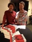 Ben Parzybok signs copies of his new novel, SHERWOOD NATION (Small Beer Press) as Brian Juenemann of PNBA looks on.