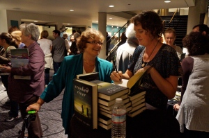 Valerie Geary signs copies of her debut novel at the Pacific Northwest Booksellers Association's Sweet and Greet, held recently in Tacoma, Washington.